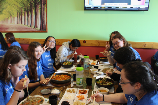 Korean language students enjoying food together at Korean restaurant.